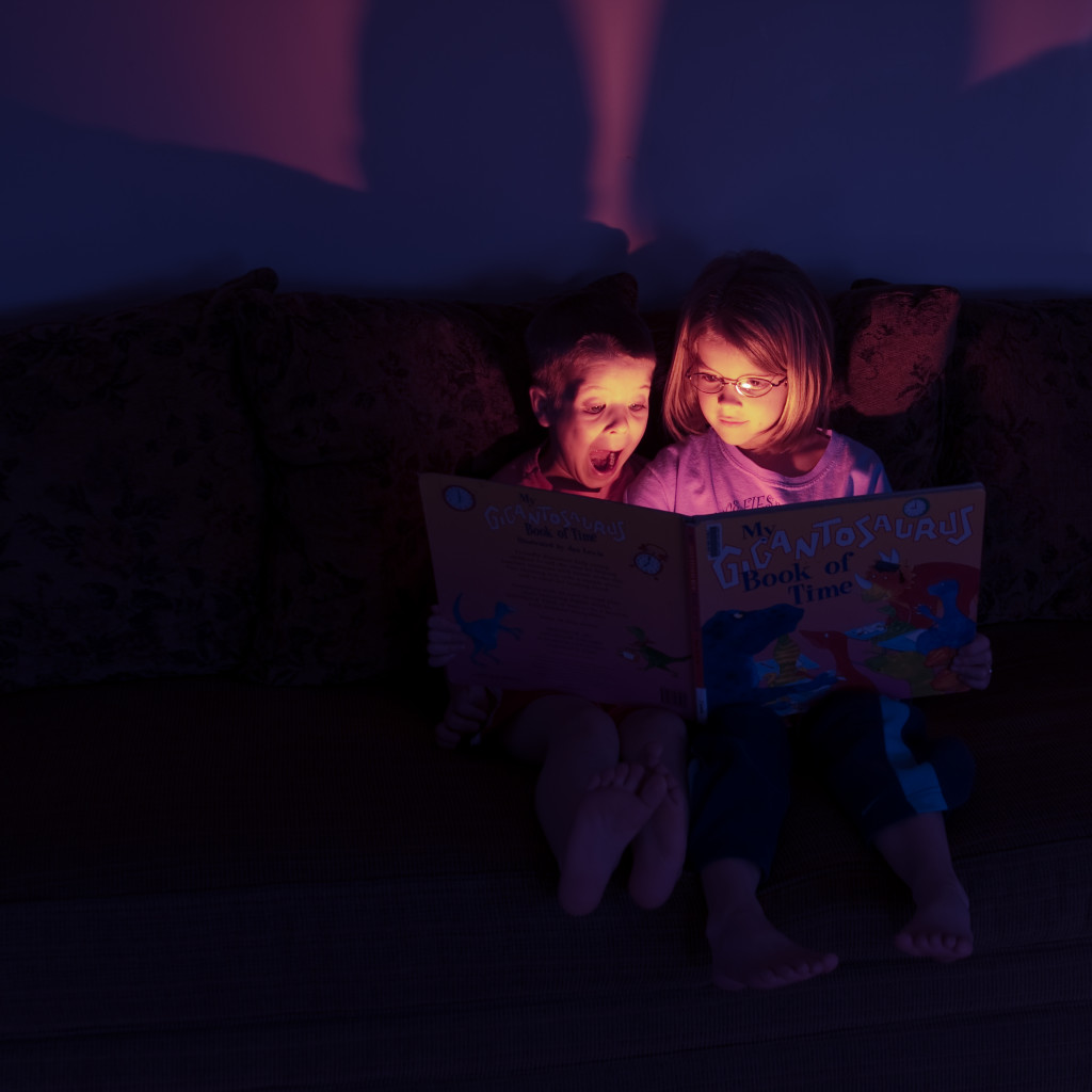 Two children reading a book